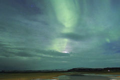 Северное сияние в небе Исландии Стоковое Фото