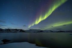 Северное сияние на ледовитом небе Стоковое фото RF