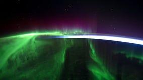 Северное сияние осматривает от космоса сердитой Северное сияние от стратосферы Северное сияние над лагуной внутри Стоковое Изображение