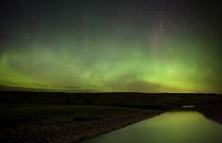 Северные света над рекой Саскачеван Стоковые Изображения