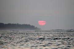 Северный заход солнца берега Стоковые Фотографии RF