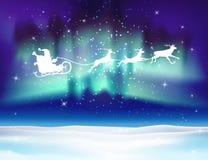 Северный олень и Санта Клаус вектора на предпосылке северного сияния Стоковое Изображение