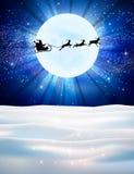 Северный олень и Санта Клаус вектора на предпосылке луны Стоковое Фото