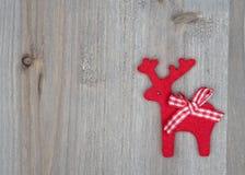Северный олень рождества на деревянном Стоковое фото RF