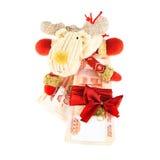 Северный олень рождества с стогом русских рублей Стоковые Фото