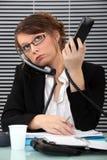 Секретарша с 2 телефонами Стоковая Фотография RF