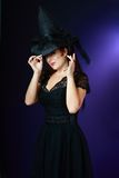 Сексуальная ведьма на темной предпосылке Стоковая Фотография RF