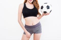 Сексуальное тело женщины с футбольным мячом Стоковая Фотография
