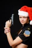 Сексуальный полисмен девушки с пушкой стоковые изображения rf