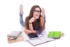 Сексуальный студент девушки делая домашнюю работу и лежа вниз Стоковая Фотография