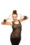 Сексуальный gesturing девушки знака рок-н-ролл изолированный на белизне Стоковая Фотография