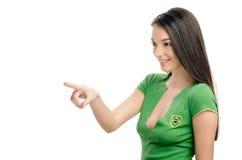 Сексуальная девушка указывая в фронт. стоковые изображения
