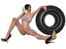 Сексуальная женщина представляя с колесом Стоковое фото RF