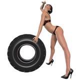 Сексуальная женщина представляя с колесом Стоковые Фото