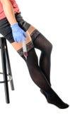 Сексуальная медсестра с большим шприцем Стоковые Фото