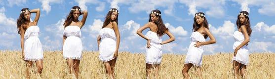 Сексуальная молодая женщина в поле пшеницы золотом стоковые изображения rf