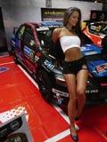 Сексуальная страсть коммерции гоночного автомобиля модели женщины Стоковое фото RF