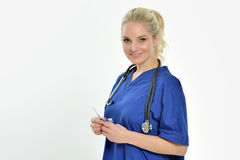 Сексуальный женский медицинский профессионал с иглой стоковое изображение