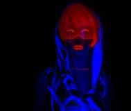 Сексуальный неоновый ультрафиолетовый танцор зарева Стоковая Фотография