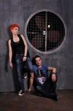 Сексуальный человек и женщина делая фотосессию моды в профессиональной студии Стоковая Фотография