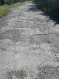 Сельские дороги ухудшают Стоковое Изображение RF