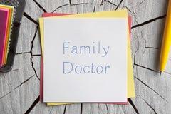 Семейный врач написанный на примечании Стоковая Фотография RF