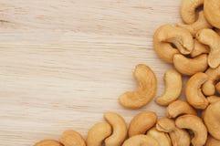 Семена анакардии на древесине Стоковое Фото