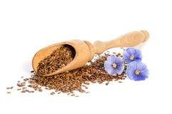 Семена льна в деревянных цветках ветроуловителя и красоты Стоковые Фотографии RF
