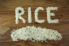 Семена риса на деревянной предпосылке Стоковое Изображение RF