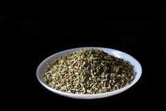 Семена тимона изолированные на черной предпосылке - изображении стоковые изображения