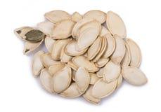 семена тыквы еды предпосылки близкие вверх Стоковая Фотография