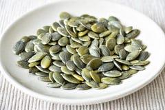 семена тыквы еды предпосылки близкие вверх Стоковые Изображения RF
