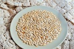 семена тыквы еды предпосылки близкие вверх Стоковая Фотография RF
