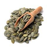 семена тыквы еды предпосылки близкие вверх Стоковые Фото