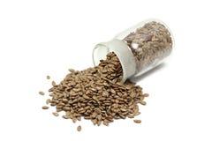 Семена льна в стеклянной бутылке Стоковая Фотография