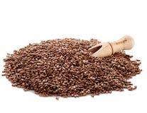 Семена льна и специя лопаткоулавливателя на белой предпосылке Стоковое Фото