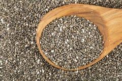 Семена Chia с ложкой Стоковые Изображения