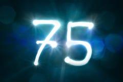 Семьдесят пять светлых год годовщины номера блеска искры стоковое фото