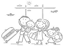 Семья в авиапорте с их багажом Стоковые Изображения RF