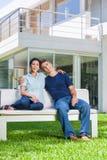 Семья в большом доме Стоковая Фотография