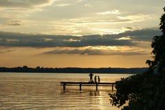 Семья в заходе солнца Стоковая Фотография RF