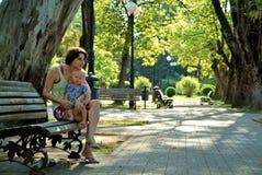 Семья в парке Стоковая Фотография RF