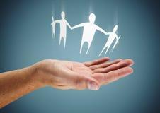 Семья в руке Стоковое Изображение