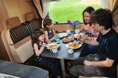 Семья есть совместно в интерьере RV Стоковые Изображения RF