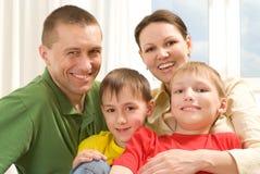 Семья играя на светлой предпосылке Стоковые Фото