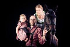 Семья из трех человек с их лошадью Стоковые Фотографии RF