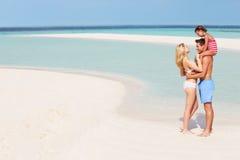 Семья имея потеху в море на празднике пляжа Стоковая Фотография RF