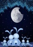 Семья кроликов в ноче Стоковые Изображения
