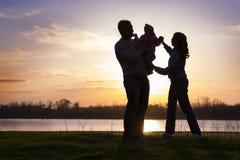 Семья на заходе солнца Стоковая Фотография RF