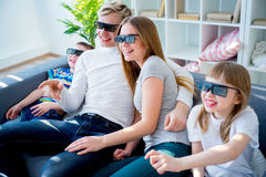 Семья на кресле Стоковые Фото